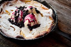 Peach Dutch Baby with Wild Blueberry Sauce - A delicious, quick and fruity dessert. This version features caramelized peaches baked into the batter and a topping of a wild blueberry sauce. Beaux Desserts, Just Desserts, Delicious Desserts, Dessert Recipes, Yummy Food, Brunch Recipes, Summer Recipes, Fall Recipes, Peach Recipes Breakfast