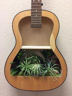 Guitar Shelf # acoustic guitar with artificial cacti and succulent garden Best Acoustic Guitar, Guitar Art, Hanging Succulents, Cacti And Succulents, Wood Guitar Stand, Guitar Shelf, Guitar Crafts, Artificial Cactus, Music Corner