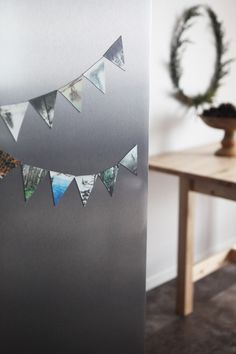 a decorative refrigerator banner with Sticky9 Magnets//