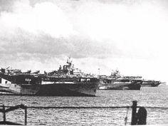 "The ""Murderers Row"" at Ulithi lagoon, December 1944, as seen from USS Wasp (CV 18): USS Yorktown (CV 10), USS Hornet (CV 12), and USS Hancock (CV 19)."