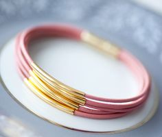 Rose leather bracelet with golden tubes - delicious enough to want to eat.  The artist is Pardes Israel.