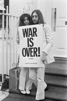 "In 1969, John Lennon left The Beatles and became as well known for his activism as for his music. Here, the singer protests the Vietnam war in London with his wife, holding a sign that reads ""War Is Over, If You Want It."""