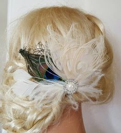 Check out this item in my Etsy shop https://www.etsy.com/listing/286974209/wedding-hair-clip-ivory-peacock-bridal