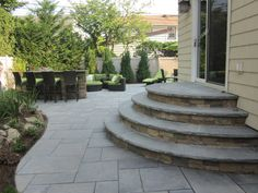 Green Island Design created these beautiful pavingstone steps, and the beautiful pavingstone patio, using Cambridge pavers.