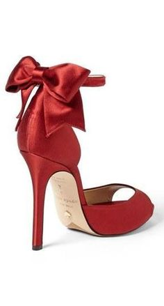 I would probably fall on my ass within minutes of putting them on! Gorgeous, red Kate Spade bow sandal.