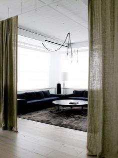 room divider. Don't care for this modern feel or color scheme. But love the idea of curtain hanging from ceiling as a room divider!
