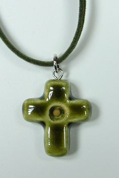 Cross pendant with embedded mustard seed. Found on Szeghalmys.com