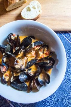 Mussels steamed in vegetable stock, coconut milk, red curry paste, and lime juice, mixed with onion and red peppers, found on http://thewimpyvegetarian.com. #SundaySupper