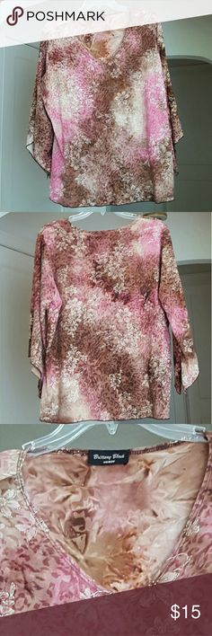 🌹 Brittany Black Angel Sleeve Blouse Flower pattern is enhanced with gold glitter. Base pattern is pink, cream and brown roses. The brown looks like an animal print. Beautiful  water color swirl of pattern and color. Polyester/spandex, hand wash, hang or lay flat to dry. Size 1X Brittany Black Tops Tees - Long Sleeve