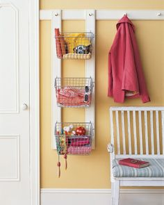 """Create an """"unloading"""" station for each family member with a peg rail for coats and accessories and a labeled bin"""