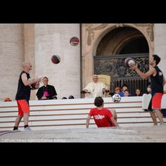 """#PopeFrancis watches as men juggle basketballs in St. Peter's square during a celebration of #sports on Saturday.   """"Sports in the community can be a great missionary tool, where the Church is close to every person to help them become better and to meet Jesus Christ,"""" the Pope told enthusiastic crowds."""