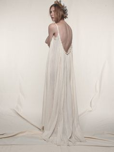 The maximal luxury of lounge comfort, our Gathered Gauze Maxi Dress celebrates your inner goddess, as barely-there straps fall to a scooped low-cut back that cascades to a train of floating gauze. - L