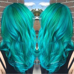 "Alyssa Wiener is a confessed ""aquaholic"" and it shows! Beautiful green to turquoise color melt with loose mermaid waves. rainbow hair unicorn hair balayage ombre hair painting"