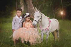 Fantasy child photography with unicorns by Cheryl McCullough