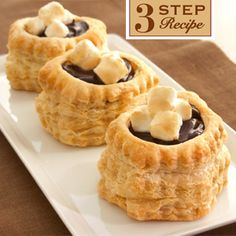 Chocolate Marshmallow Tarts Recipe... This dreamy dessert features golden puff pastry shells filled with chocolate pudding and fluffy marshmallow creme. This is loved by kids and adults alike!