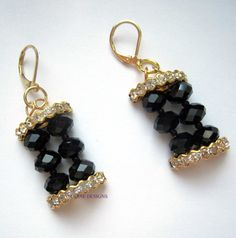 Get this fashion earrings for you or as a treat for that special someone and make her day!    Latest Lucine Designs black statement earring for you