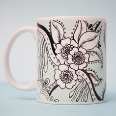 To the innocent viewer this mug is just a pretty floral pattern set on a mint-green background but on the other side (the interior side facing you) there's a secret message that only the holder…