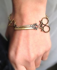 Antique brass scissor bracelet - wish bracelet. $8.50, via Etsy.