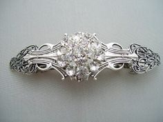 A pretty, classy barrette.  These are hard to find and would be so cute in half up, half down dos.