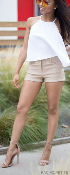 Women's khaki shorts, with white tank top and kate spade cross body purse quay quay sunglasses by desi perkins. perfect outfit for spring, summer. casual, chic, classy and trendy #khakishorts #whitetanktop #tanktop #springoutfit #summeroutfit