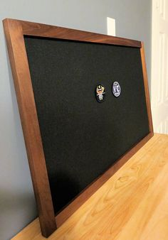 Our Military Morale Patch Display Frame is beautifully handcrafted with elegant construction of solid walnut, this custom made frame has been specifically designed for you to display your memorabilia and other swag on your wall! This will undoubtedly make a stunning addition to your home. We build these frames to order, so feel free to message us for custom sizing. The finished product is hand sanded for maximum smoothness and sealed with a poly/oil and poly/wax finish. The board i...