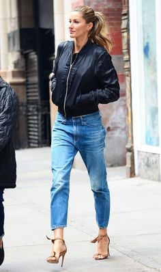 The ultimate cool-girl outfit: boyfriend jeans, a bomber jacket, and ankle strap heels