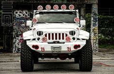 """Jeep Wrangler w/ complete white carbon fiber wrap, custom LED side steps, Magnaflow exhaust, lifted on 24"""" XD Rockstar wheels, complete custom Focal and JL Audio sound system"""