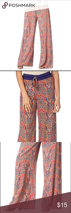 NWT Miss Me NORTHERN LIGHTS PALAZZO PANTS Small A wide drawstring waistband tops a pair comfortable palazzo pants in a vibrant print and wide-leg silhouette. -100% Rayon -Gentle Machine Wash Cold Miss Me Pants Wide Leg