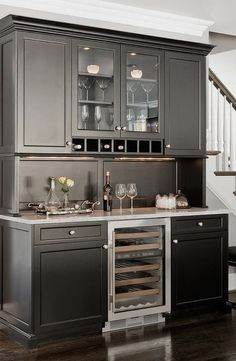 #homedecor #kitchenideas #inspiration   Photo of a traditional kitchen in Boston with glass-front cabinets, black cabinets, granite countertops and stainless steel appliances. — Houzz