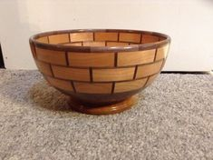 Segmented wood bowl made from walnut and cherry with an acrylic finish. Measures 5.25 Tall x 10.5 in Diameter.