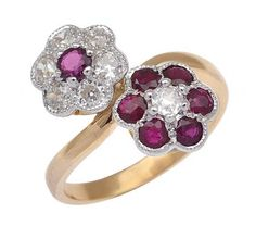 A RUBY AND DIAMOND DOUBLE CLUSTER RING - Price Estimate: $3400 - $4800