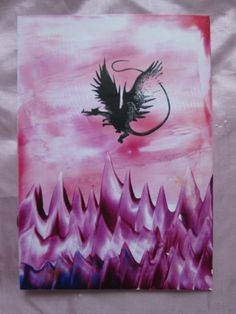 Encaustic wax art painting of a dragon. I used an ink stamper to create the dragon silhoutte and then layered over coloured beeswax with a small flat iron. To see this on my etsy account visit:  https://www.etsy.com/uk/shop/GemmasFantasyCrafts?section_id=18314503&ref=shopsection_leftnav_2