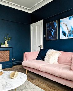 Velvet decor is in right now and I am loving this pink velvet sofa! Blue And Pink Living Room, Navy Living Rooms, Living Room Sofa, Pink Velvet Sofa, Pink Couch, Dark Blue Feature Wall, Navy Gold Bedroom, Living Room Decor Inspiration, Master Bedroom Interior