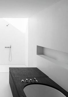 Pascal François Architects #minimalist #tub @CheviotProducts thinks wooden counter and tub encasement is very cool.