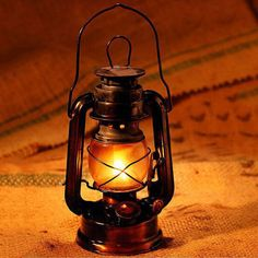 Traditional classic old Kerosene Lantern Lamp, NOT LED Lantern,bring your mind back to the past time Made of durable metal case with Plexiglass panels. Can be hung or use…