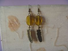 Items similar to feather pendant earrings, yellow and bronze refashioned earrings on Etsy Pendant Earrings, Drop Earrings, Nickel Free Earrings, Feather Design, Amber Color, Refashion, Bronze, Pendants, Etsy Shop