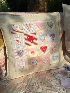 HenHouse:pretty appliqué pillow with ticking and stripes--love this combination
