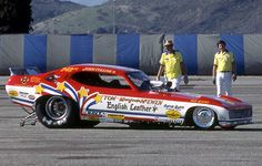"""Tom """"the Mongoose"""" McEwen in his English Leather Corvette funny car. Funny Car Drag Racing, Nhra Drag Racing, Funny Cars, Auto Racing, Car Photos, Car Pictures, Car Pics, Snake And Mongoose, Old Race Cars"""