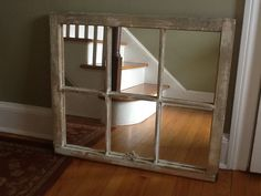 great idea for the antique window frames i just bought... put a mirror behind them!  need to find somewhere that can custom cut mirrors.