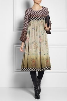 Vineet Bahl uses India's native embroidery techniques to create its beautiful designs. Cut with an empire-line waist, this loose-fitting satin dress showcases polka dot, check and floral motifs, all inspired by the arts and culture of the Ottoman Empire.