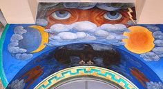 """Detail from the Coit Tower mural, """"Animal Force"""", by artist Ray Boynton. The artist painted the celestial eyes over an elevator doorway on the building's first floor. Photograph by Mark Vallen ©."""