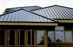 The best metal roof in the industry. Standing seam metal roofing and metal shingles that look like wood shake, slate, and clay tile. Our metal roofs are made in the USA with recycled aluminum, and are backed with a comprehensive limited lifetime warranty. Metal Roofing Systems, Roofing Materials, Roofing Services, Roofing Contractors, Metal Roof Over Shingles, Residential Metal Roofing, Architectural Shingles, Roof Colors, Cool Roof