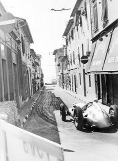 Rudolf Caracciola taking a sharp corner with his Mercedes-Benz W154, in the Coppa Ciano, in and around Livorno, Italy, 1938.