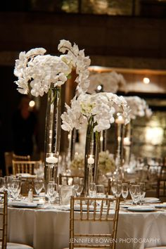 Tall white orchid floral centerpieces