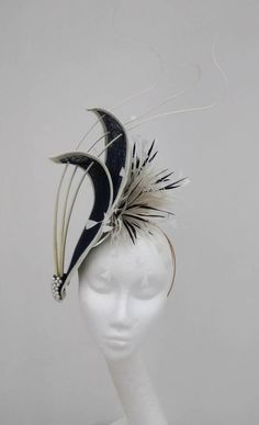 Striking hatinator in navy and ivory . Hats and fascinators for weddings, mother of the bride, race meetings and special occassions by JayneAlisonMillinery on Etsy