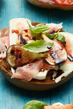 Whole-wheat bagel, Brie, fresh figs or sliced pear, prosciutto, basil, and a drizzle of balsamic.   - Redbook.com