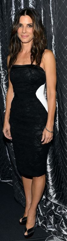 Who made  Sandra Bullock's white strapless dress and black pumps that she wore in New York on October 3, 2013?