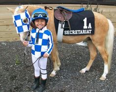 This might be the cutest costume ever. I used to pretend that my own pony was a racehorse