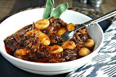 Braised Beef Short Ribs -- a slow-cooked hearty ragu served with potato gnocchi.