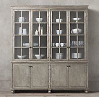 RH's Annecy Metal-Wrapped Glass 4-Door Sideboard & Hutch:Drawing inspiration from French industrial designs of the early 20th century, our collection celebrates the art of hand-wrapped sheet metal. Painstakingly constructed, each piece features sheet metal secured by thousands of hand-hammered nails using a centuries-old technique. In a finishing process that takes from 7-10 days per silhouette, the metal is buffed by hand and antiqued through oxidation, displaying highs and lows that...